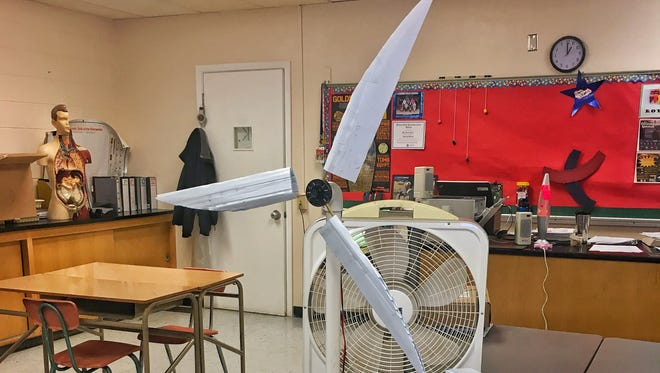 Samuel Hindi's students built a wind turbine as their science project in their Corona High School classroom.