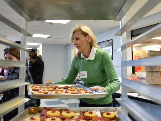 Nora Renzulli of Wayne volunteering her time to serve meals at Eva's Village in Paterson.
