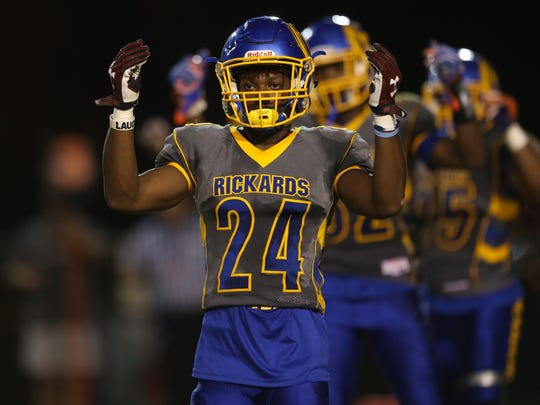 Rickards' Tavyn Jackson signals back to his coaches during their game against Wakulla at Cox Stadium on Thursday night.