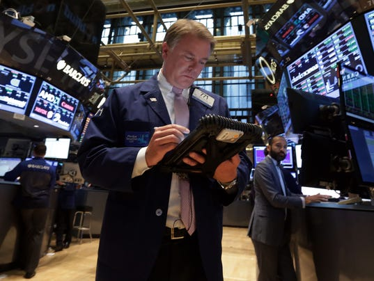 In this Sept. 18, 2013, file photo trader F. Hill Creekmore works on