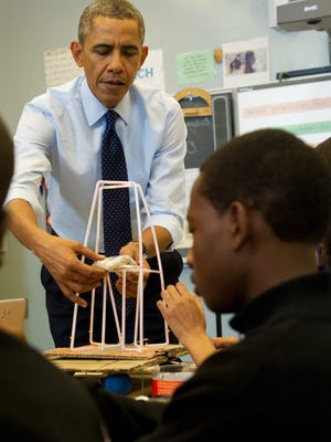 President Barack Obama helps adjust a model for a Earthquake Tower Challenge problem during a visit Oct. 25, 2013, to a classroom at Pathways in Technology Early College High School, in Brooklyn, N.Y. Although New York City schools don't spend the most per pupil in the state, in 2009-10 officials did spend $20,276 per student.