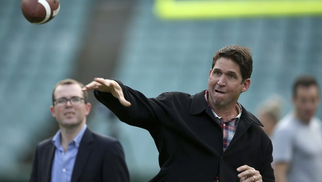 Three-time Super Bowl champion Ed McCaffrey throws a ball during a promotion for the Sydney Cup in Sydney, Australia, featuring Stanford University and Rice in the first college football game of 2017.