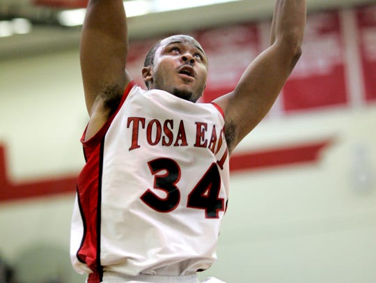 Tosa East's Jerry Smith slams it home during a game in 2006. Smith, who later played at Louisville, was our All-Suburban Player of the Year in 2005 and 2006.