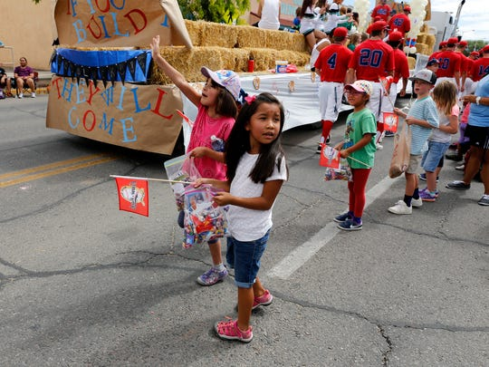 First-grade students from the Emmanuel Baptist Church summer camp wait for candy during the Connie Mack World Series Parade in Farmington on Friday.