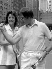 The real Bobby Riggs flexes for Billie Jean King before