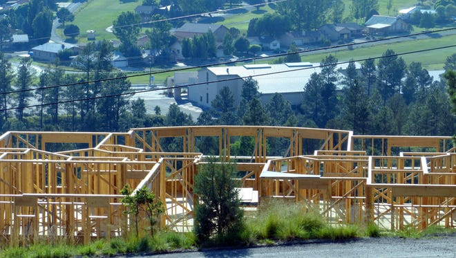 A new home is being built overlooking Cree Meadows Golf Course.