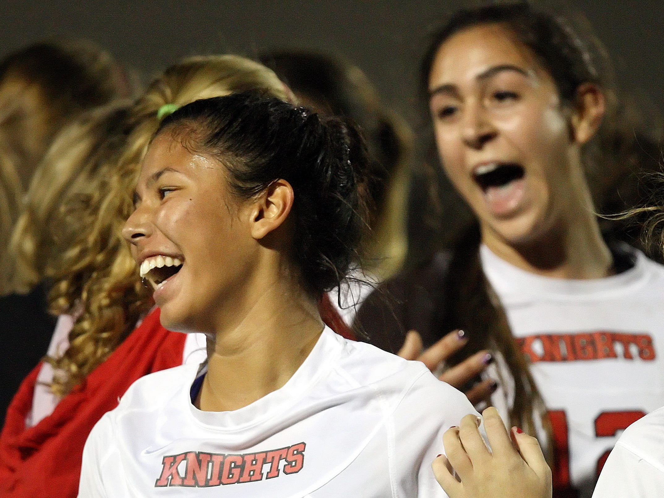 North Fort Myers High School's Makenzi Walden, left, and teammates celebrate beating Ida S. Baker in the District 3A-13 girls soccer final Friday at Ida S. Baker High School in Cape Coral.