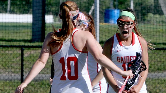 Kerri Gutenberger of North Rockland, right, celebrates