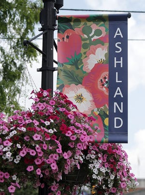 The new Ashland banners and the hanging baskets are seen here at the corner of Claremont Avenue and West Main Street on Friday.
