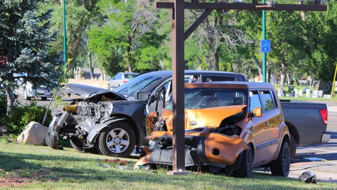 The scene of an early morning crash on Main Street in Cedar City on Saturday, June 18, 2016.