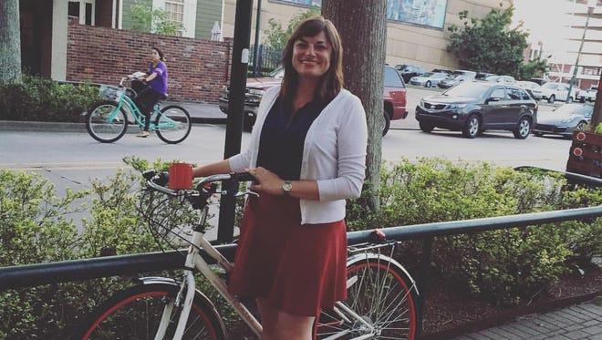 Kate Durio bikes to work.