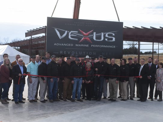 Vexus Boat employees are joined by business partners