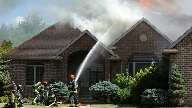 Fire fighters from Grand Chute and Appleton battle a blaze Saturday at 5501 W. Natures Lane in Grand Chute.