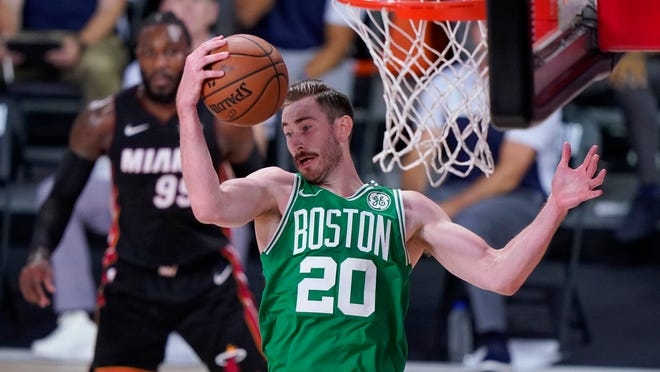 Celtics forward Gordon Hayward comes down with a rebound during the first half of Game 3 Saturday night.
