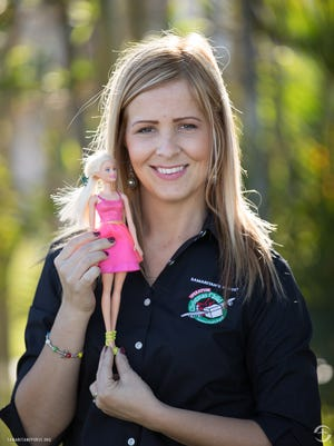 Nadia Karnatova from Ukraine poses with a Barbie doll. Karnatova extols the virtues of Operation Christmas Child, an annual gift-giving effort run through local churches across the country.