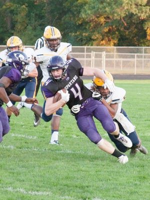 Lakeview's Cameron Gillette (4) gets tackled against Portage Central on Friday.