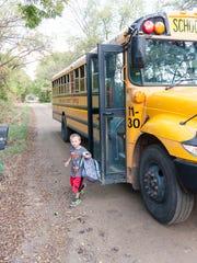 Landyn Cooley, 6, arrives back home after a day at