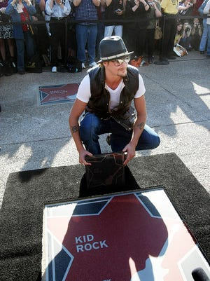 Kid Rock shows off his star during the Music City Walk of Fame Induction ceremony at the Country Music Hall of Fame Nov. 8, 2009.