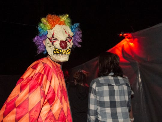 Creepy clowns scare visitors in the Haunted Hike at Mike Greenwell's on Saturday, October 22, 2016, in Cape Coral.