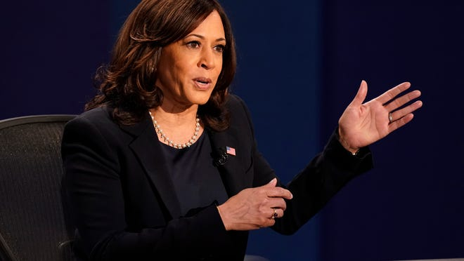 Democratic candidate Sen. Kamala Harris, D-Calif., and Vice President Mike Pence speak during the vice presidential debate on Wednesday at Kingsbury Hall on the campus of the University of Utah in Salt Lake City.