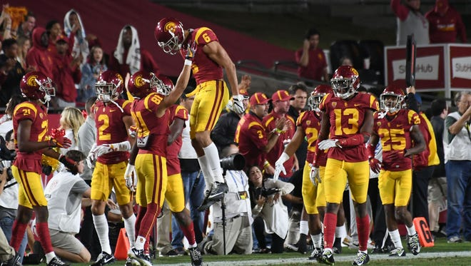 Southern California Trojans wide receiver Michael Pittman Jr. (6) celebrates with teammates after returning a punt for a touchdown.