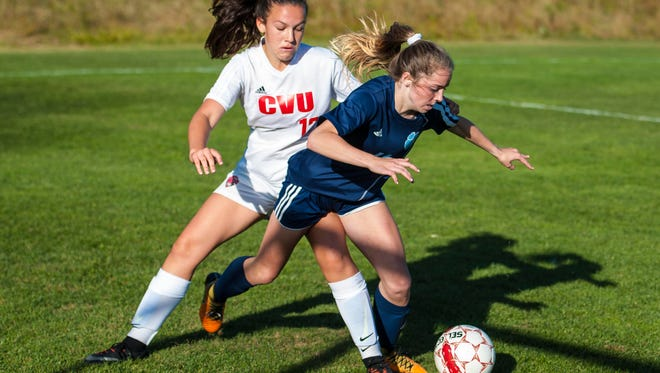 Champlain Valley Union's Dylan Walker, left, tangles with Mt. Mansfield Union's Emily Zambarano in Hinesburg on Tuesday, October 3, 2017.