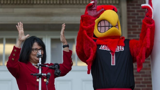 "Incoming University of Louisville President, Dr. Neeli Bendapudi, threw up the ""L's"" along with the Cardinal Bird on her first day of work. May 15, 2018."