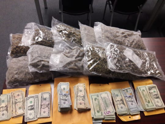 More than 10 pounds of marijuana and cash were found