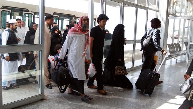 """Travelers navigate the Sanaa International Airport as international airlines resume flights to Sanaa on Wednesday, Sept. 24, 2014. Flights to the Yemeni capital were suspended because of the threat of violence. Yemeni President Abdrabuh Mansur Hadi is warning of """"civil war"""" since Shi'ite rebels seized much of the capital."""