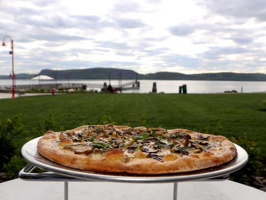 Black truffle pizza, with shiitake mushrooms and fontana cheese, on a table in the patio seating area at 3 Westerly in Ossining. This pizza is a fave of @hungryhungry.