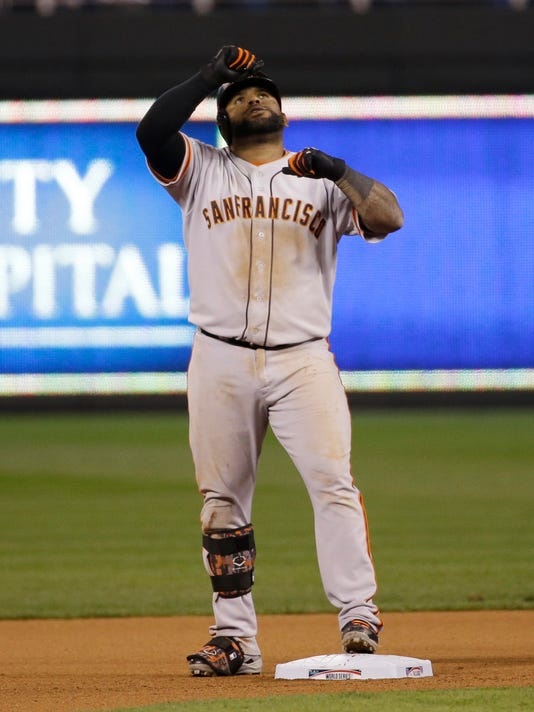San Francisco Giants Pablo Sandoval celebrates after hitting a double to left field during the eighth inning of Game 7 of baseball's World Series against the Kansas City Royals Wednesday, Oct. 29, 2014, in Kansas City, Mo.  (AP Photo/Matt Slocum)