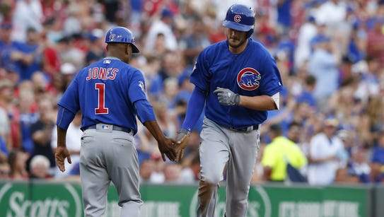 Cubs third baseman Kris Bryant rounds the bases after