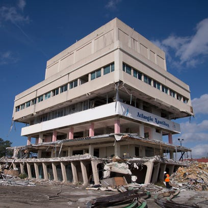 The Glass Bank in Cocoa Beach is seen being torn down