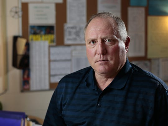 Former assistant football coach Danny Mullins poses behind the desk in his classroom at Mason High School in Mason, Ohio, on Wednesday, Jan. 4, 2017. Mullins left the football program last year because of the way he says the head coach handled allegations of sexual offenses against football player Bryson White.