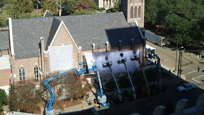 A movie crew is seen outside St. Peter's Catholic Cathedral in downtown Jackson Tuesday.