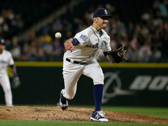FILE - In this May 31, 2017, file photo, Seattle Mariners relief pitcher Steve Cishek throws in the sixth inning of a baseball game against the Colorado Rockies in Seattle.  The Tampa Bay Rays continued to bolster their bullpen for the pennant race on Friday, July 28, 2017, acquiring Cishek from the Mariners in exchange for versatile right-hander Erasmo Ramirez.  (AP Photo/Ted S. Warren, File)