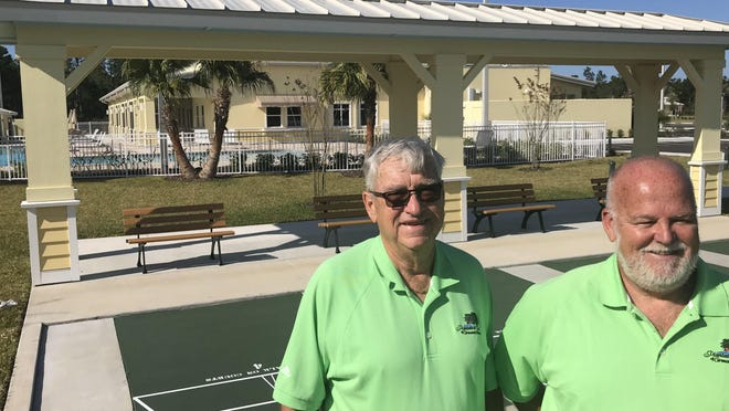 In this 2019 photo, Ormond Beach developer Ronnie Bledsoe, left, stands next to partner Parker Mynchenberg behind the newly completed clubhouse for the Plantation Oaks 55-and-older community they are developing in Ormond Beach Bledsoe, 70, died on Tuesday.