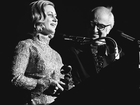 Dixie Hall, left, accepts the Grammy award on the behalf of her husband, Tom T. Hall, for Best Album Notes during the champagne breakfast and the final 36 presentations of the Grammy awards at the Municipal Auditorium after the nationally televised show March 4, 1973.