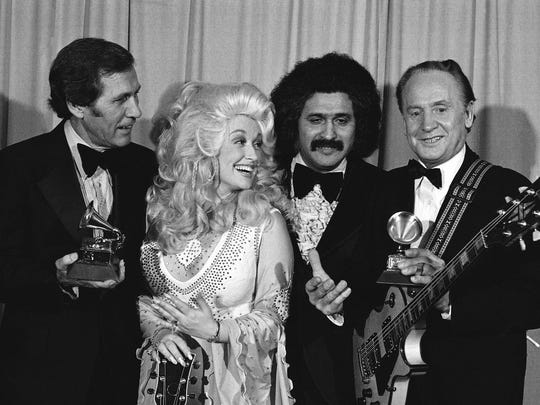 In this Feb. 19, 1977 file photo, Les Paul, right,