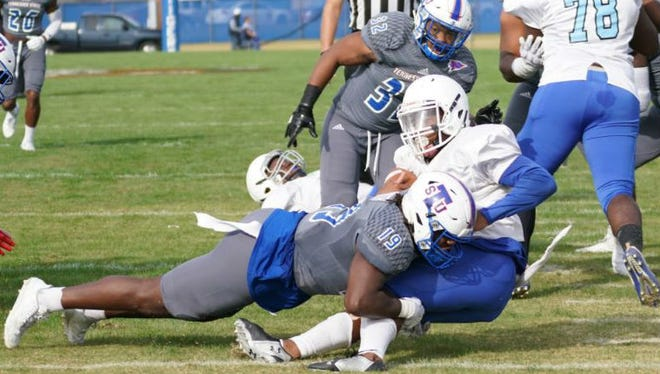 Tennessee State linebacker Justin North (19) tackles a Virginia-Lynchburg running back during Saturday's game Hale Stadium.
