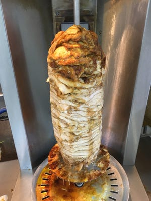 Al Rayan Restaurant serves up chicken shawarma, which is roasted on a spit.
