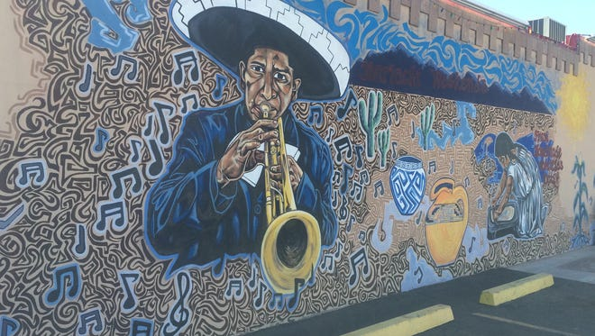 This mural at La Perla features a man in a sombrero playing a trumpet. The artist is Edgar Fernandez.