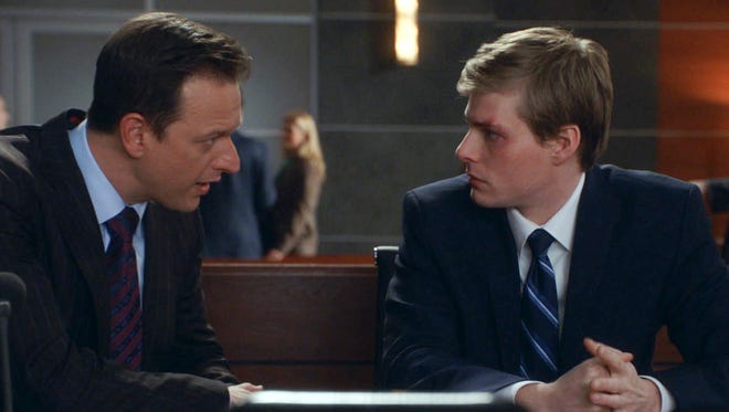 Will (Josh Charles) confers with his client (Hunter Parrish), who is on trial for murdering a classmate.
