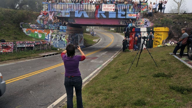 Pensacola photographer Rachael Pongetti takes a shot of the 17th Avenue train trestle, known popularly in Pensacola as Graffiti Bridge. Pongetti took photos of the bridge every day for a year. PNJ file photo
