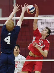 Laekand's Connor Field attempts a spike in the Passaic