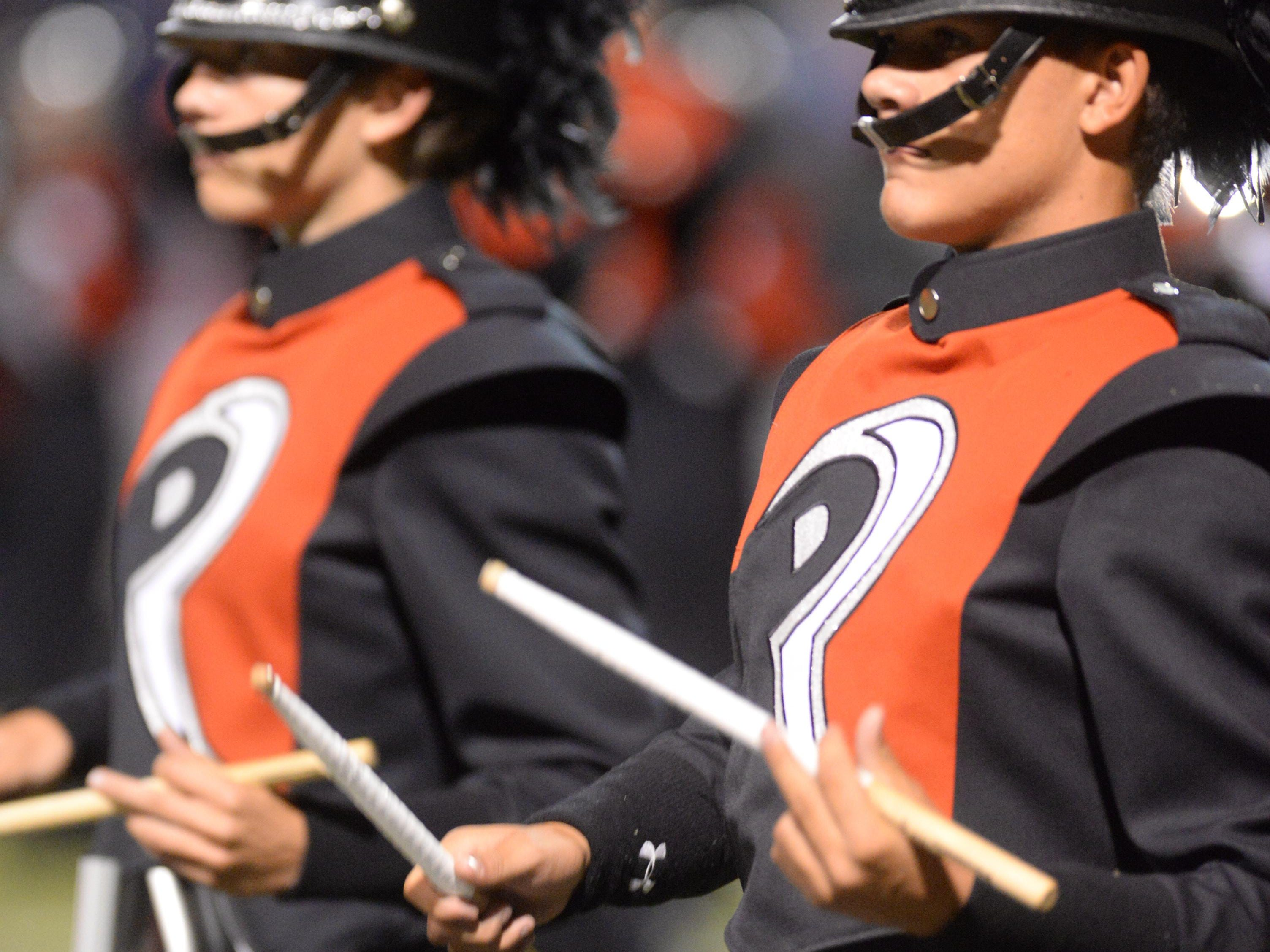 The Parkway High school marching band drummers keep beat as they perform for the crowd during their halftime show.