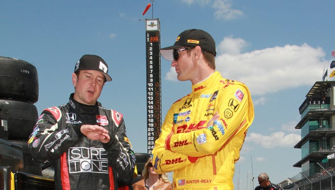 Kurt Busch (left) and Ryan Hunter-Reay discuss track conditions before Indianapolis 500 qualifying on Sunday.