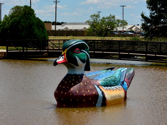 "In this file photo, ""Wally the Wood Duck"" is seen at Souith Weeks Park Pond at the Northwest Texas Field and Stream off Southwest Parkway. Area artist Ralph Stearns and his brother Richard worked on the sculpture for four months."