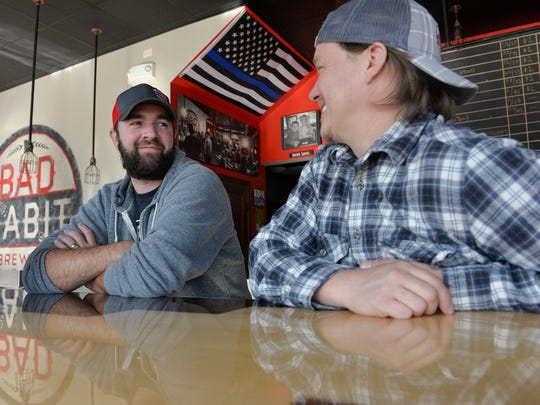 Brewery co-founders Aaron Rieland and Eric Geier talk on Monday, Oct. 24, at Bad Habit Brewing Co. in St. Joseph.