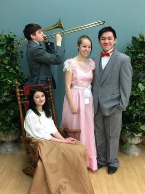"Treehouse Theater will present the musical ""The Music Man Jr."" Cast members include Sylvie Bennetts, center, King Hang, right, Halle Nagel, seated, and Sam Schoepp."